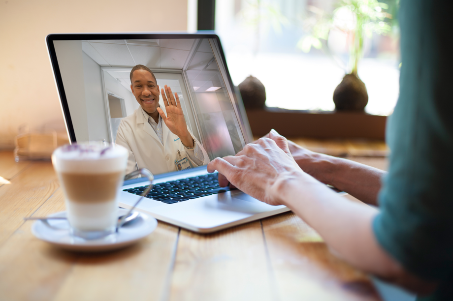 woman videochatting with doctor on a laptop
