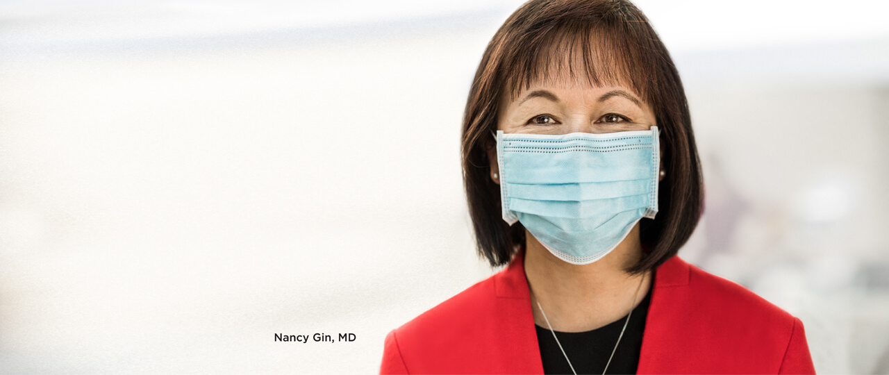 A photo of Nancy Gin, M D wearing a mask.